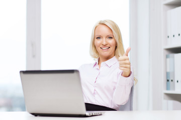 smiling businesswoman or student with laptop