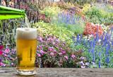 Enjoy beer in colorful flower garden.