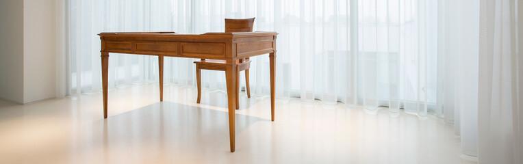 Wooden, vintage desk inside pure interior