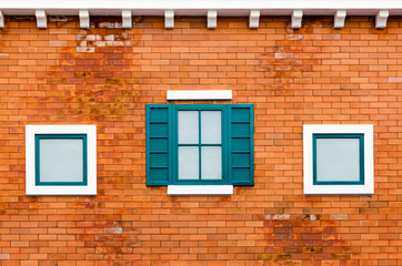 Window on the orange brick wall