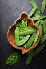 fresh organic mangetout, also known as sugar snap pea