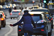 canvas print picture - Winter city scene. Woman on bike in traffic
