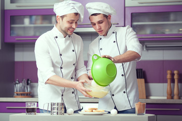 Tiramisu cooking concept. Portrait of two funny men cooking