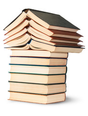 Stack of open and closed old books rotated
