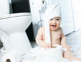 Fototapety Toddler ripping up toilet paper in bathroom