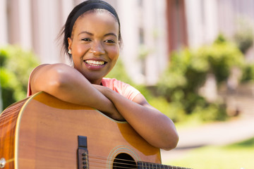young african woman with a guitar