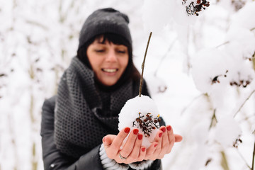 girl and a branch with snow