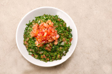 Plate of traditional Arabic salad tabbouleh