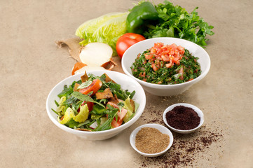 Plates of traditional Arabic salad fattouch and tabbouleh