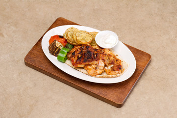 Grilled chicken fillets, with potatoes and vegetables