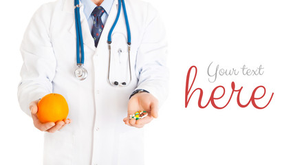 medical doctor with pills in one hand and orange in other isolat