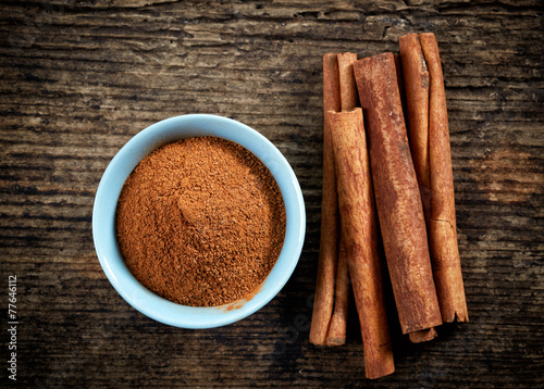 canvas print picture cinnamon powder and sticks