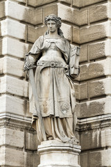 Sculpture of a woman with a book and a sword in Vienna