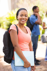 female african college student with backpack