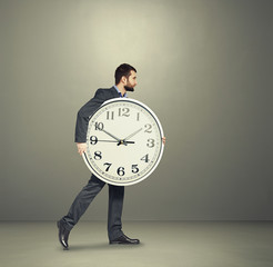man with clock going forward