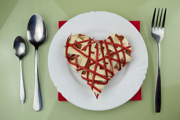 Handmade red heart on plate