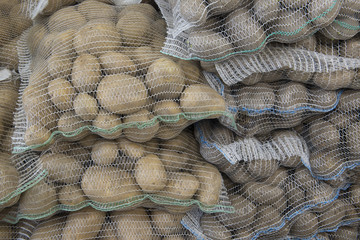 potatoes in mesh bags close-up