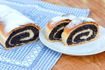 Strudel with poppy seeds on table