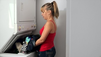 Woman Washing Dirty Clothes In Laundry Machine