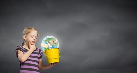 Kid with bucket