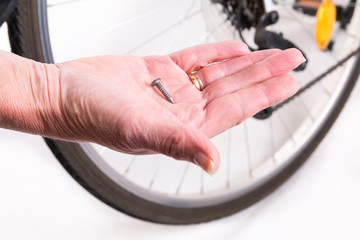 Sharp nail in the wheel of the bicycle