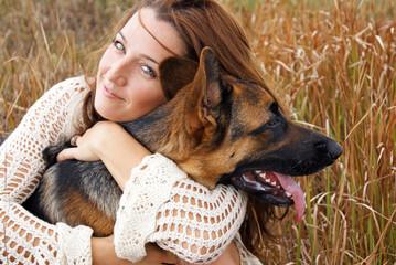 Pretty woman with german shepherd dog