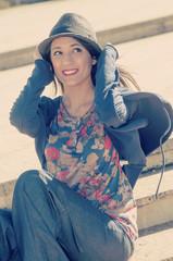 girl holding hat instagram filter applied