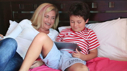Mother and son with a digital tablet