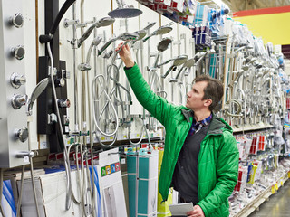 Man shopping for bathroom equipment in shop