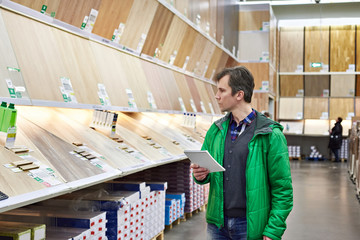 Man shopping laminate in DIY shop