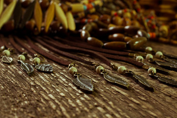 Ethnic jewelry closeup on a wooden surface