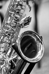 Fragment of the saxophone in black and white