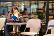 Young woman with a book in cafe
