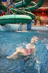 Llittle girl swimming in aquapark