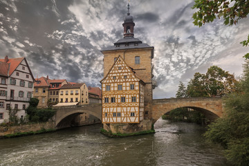 Obere bridge and Altes Rathaus and cloudy sky, sepia
