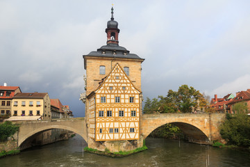 Obere bridge and Altes Rathaus and cloudy sky in Bamberg, German