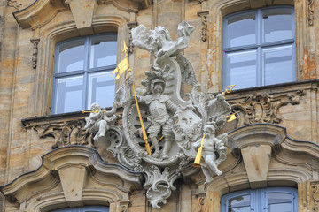 Knight with spear and angels with trumpets statues in Bamberg