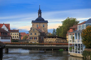 Bridges, Altes Rathaus and cloudy sky in Bamberg