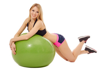 Sexy blonde laying on green fitness ball