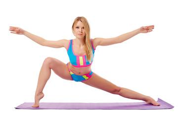 Flexible blonde warming up looking at camera