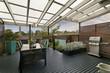 Leinwanddruck Bild - backyard cozy patio area with wicker furniture set
