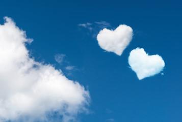 blue sky with hearts shape clouds