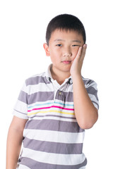Boy having a toothache holding his face with his hand, isolated