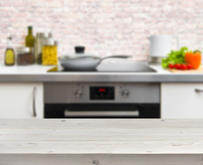 Wooden table on defocused rastic kitchen background