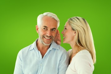 Composite image of woman whispering a secret to husband