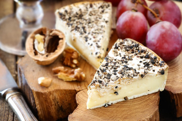 White mold cheese like Brie or Camambert with black papper