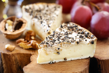 White mold cheese like Brie or Camembert with black papper