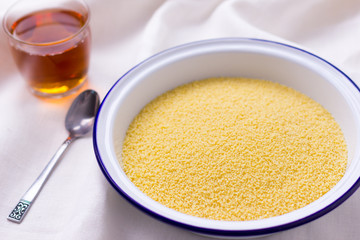 bowl of couscous on white tablecloth