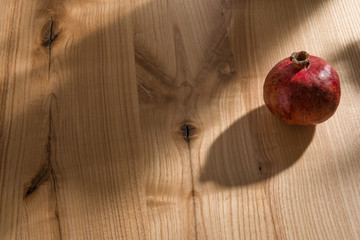 Pomegranate fruit on a wooden table