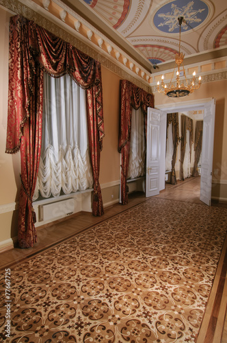 In the large hall windows, which shuttered French curtains - 77667725